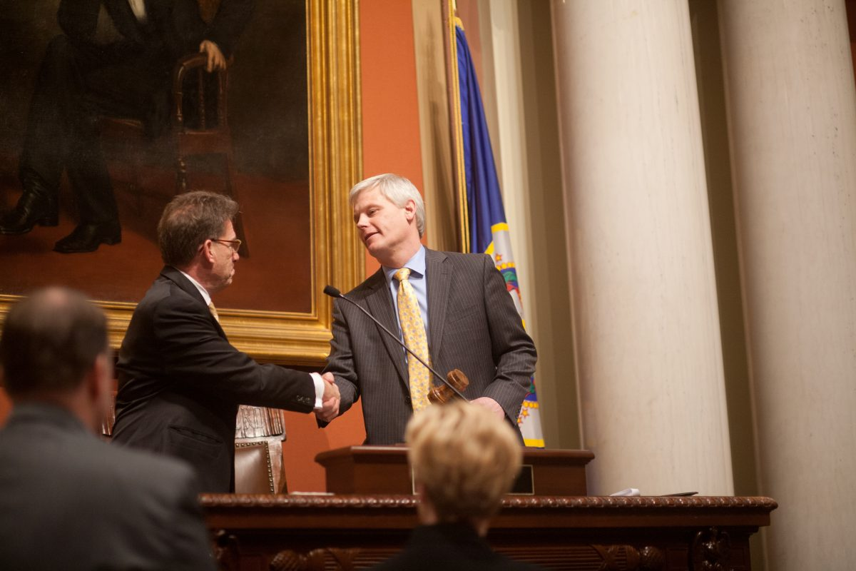 Speaker of the House Paul Thissen shakes hands with Secretary of State Mark Ritchie